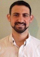 A photo of Adam, a tutor from Ithaca College