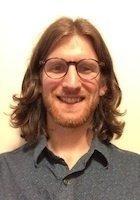 A photo of Reid, a tutor from Wesleyan University