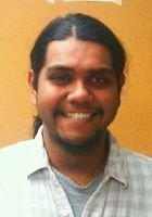 A photo of Navindra, a tutor from CUNY Queens College