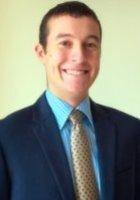 A photo of Aaron, a tutor from George Washington University