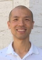 A photo of Tony, a tutor from Beijing Foreign Studies University