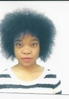 A photo of Taïsha, a tutor from CUNY John Jay College of Criminal Justice