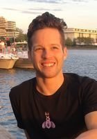 A photo of John, a tutor from Harvard University