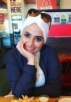 A photo of Enas, a tutor from Arab International University