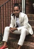 A photo of Tashé, a tutor from Howard University