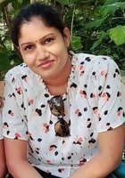 A photo of Asha, a tutor from University of Kerala