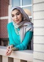 A photo of Amina, a tutor from Yale University
