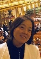 A photo of Wei (Elaine), a tutor from Huazhong University of Science and Technology