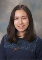 A photo of Aya, a tutor from Carleton College