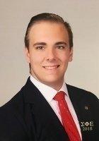 A photo of Ian, a tutor from Washburn University