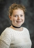 A photo of Audrey, a tutor from Grinnell College