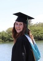 A photo of Maya, a tutor from Eckerd College