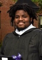 A photo of N'Adom, a tutor from Wheaton College (Illinois)