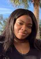 A photo of Abimbola, a tutor from Florida Institute of Technology