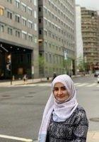 A photo of Muzhda, a tutor from Kabul University