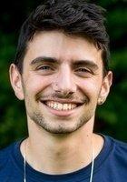 A photo of Eli, a tutor from Wesleyan University
